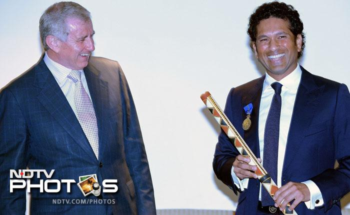 Indian cricketer Sachin Tendulkar (R) looks on after being conferred with the membership of The Order of Australia by Simon Crean (L), Australian Minister for Regional Australia, Regional Development and Local Government, during a ceremony in Mumbai.