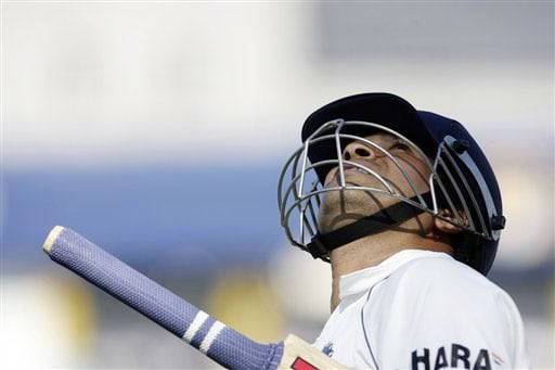 Indian batsman Sachin Tendulkar looks skyward as he achieved the world record for the most runs in Test in Mohali.