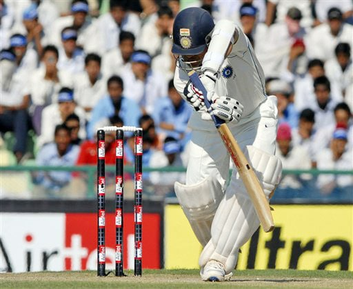 Sachin Tendulkar plays the shot that got him to cross the world record during the first day of the second Test match between India and Australia in Mohali.