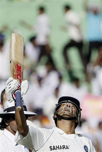 Sachin Tendulkar reacts after becoming the leading run-scorer in Test cricket on the first day of the second Test match between India and Australia in Mohali.