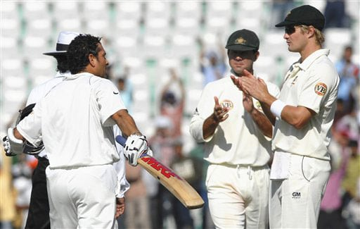 Australian captain Ricky Ponting and Shane Watson applaud Sachin Tendulkar for becoming the leading run-scorer in Test cricket during the first day of the second Test match between India and Australia in Mohali.