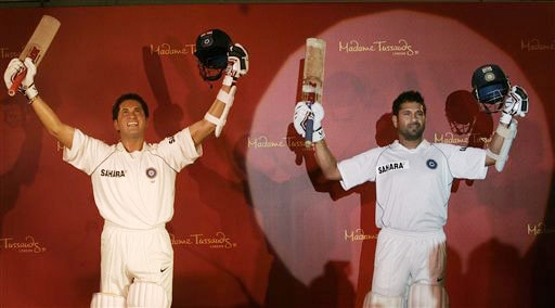 Sachin Tendulkar poses next to his wax figure in Mumbai on April 13, 2009. The figure has been made to go on show at London's Madame Tussauds Museum. (AP Photo)