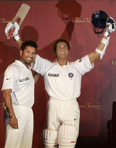 Sachin Tendulkar poses next to his wax figure in Mumbai. (AP Photo)