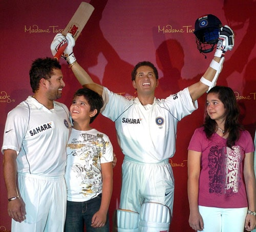 Sachin Tendulkar, with his kids Arjun and Sara at the unveiling of his wax statue, to be kept at the Madame Tussauds Studios in London. (PTI Photo)