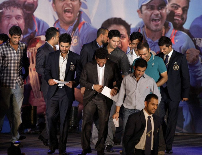 Captain MS Dhoni leads the Indian cricket team off the stage.