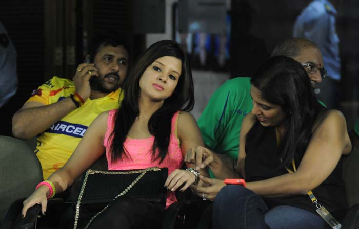 Seen here with a friend during Chennai Super Kings' match against Kings XI Punjab at Mohali. (BCCI Image)