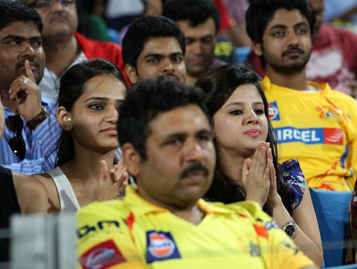 Whenever Chennai Super Kings play and Dhoni takes to the field, one fan keeps all her fingers crossed. Yes, Sakshi Dhoni (right) is an ardent admirer of the side and the skipper- her husband MS. Here she catches the team in action against Pune Warriors.