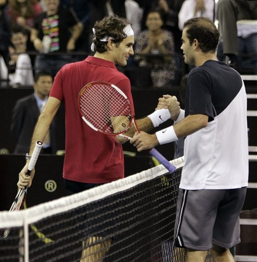 Roger Federer of Switzerland, left, shakes hands with Pete Sampras of the United States.