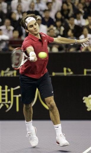 Roger Federer returns the ball.