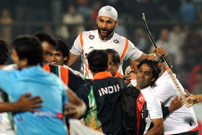 He cut his birthday cake in the presence of his teammates, who themselves were in a song and dance mood for a double celebration for the Indian hockey team. (AFP Photo)