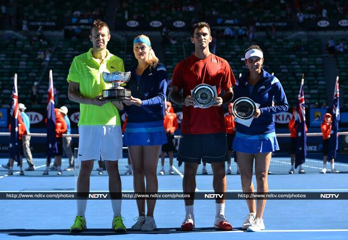 India's Sania Mirza and Horia Tecau of Romania came out second best against Daniel Nestor of Canada and Kristina Mladenovic of France in the final of the Australian Open mixed doubles event. <br><br>All images courtesy AFP.