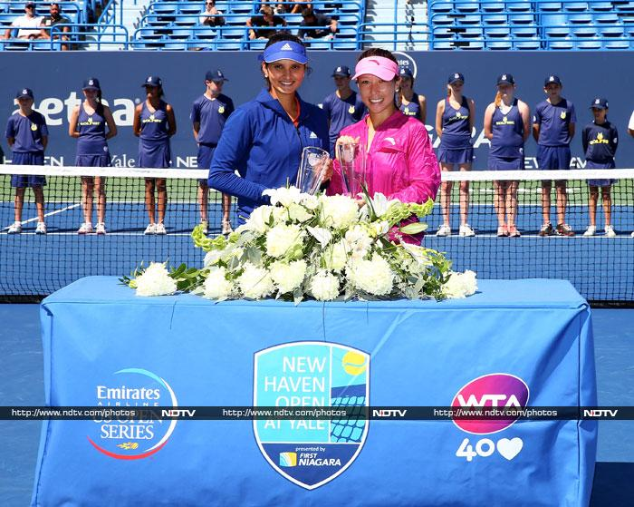 India's Sania Mirza has had a decent 2013 so far and added another feather to her cap when she won the women's doubles trophy at the WTA New Haven Open along with new partner Jie Zheng. <BR><BR>Image courtesy AFP