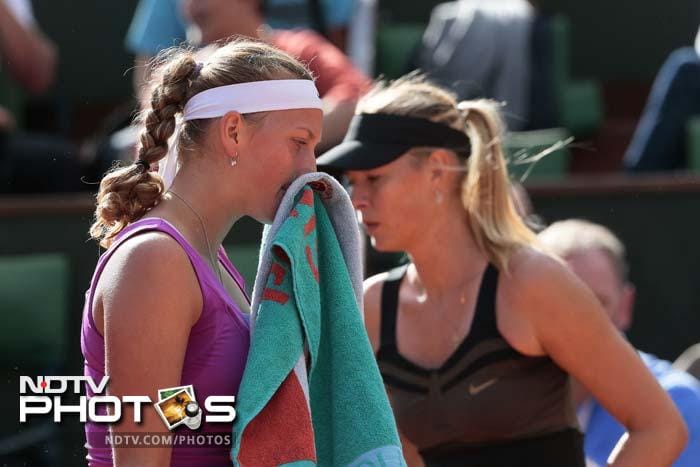 Sharapova, at an imposing 1.88m, and Kvitova, just 5cm shorter, both struggled for accuracy in the testing conditions on Philippe Chatrier court, where the wind whipped up the clay and helped balls sail out. But it was Sharapova who quickly adapted her game.