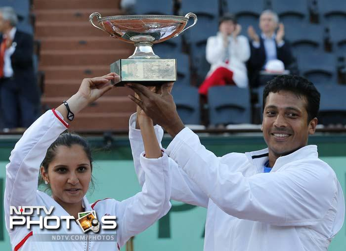 Sania Mirza and Mahesh Bhupathi won their second Grand Slam title together and first French Open trophy after crushing the challenge of Klaudia Jans-Ignacik and Santiago Gonzalez in the mixed doubles final. (All AFP and AP Images)