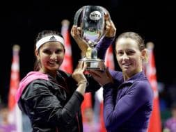 Photo : Sania Mirza - Cara Black Storm to Victory in Maiden WTA Finals Appearance