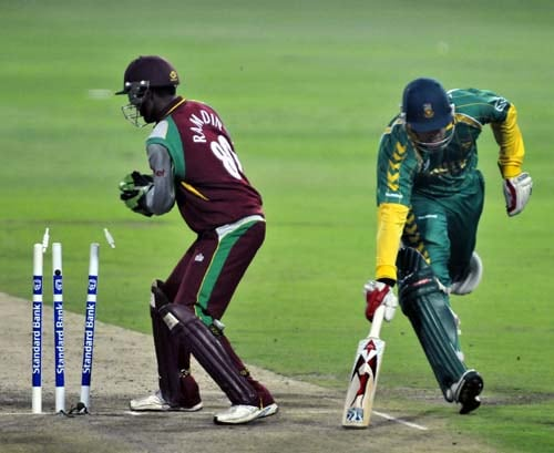 Shaun Pollock narrowly escapes a run out by West Indies keeper Denesh Ramdin, left, during their first Pro 20 international in Johannesburg on Friday, January 18, 2008.