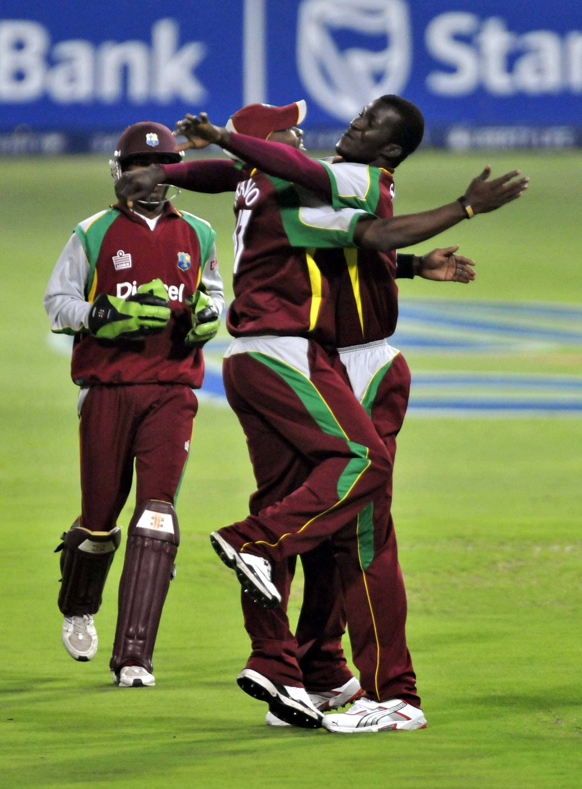 Daren Sammy & Dwane Bravo celebrate taking the wicket of JP Duminy, during their first Pro 20 international in Johannesburg on Friday, January 18, 2008.