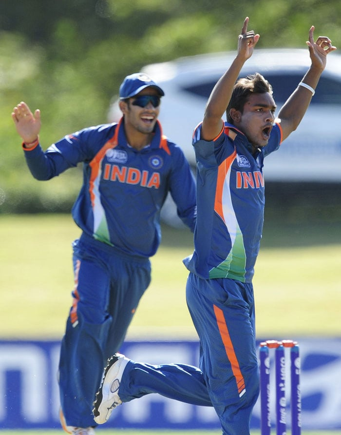Sandeep Sharma of India celebrates the wicket Sami Aslam of Pakistan during the ICC U19 Cricket World Cup 2012 Quarter Final match between India and Pakistan at Tony Ireland Stadium on August 20, 2012 in Townsville, Australia. (Photo by Ian Hitchcock-ICC/Getty Images)