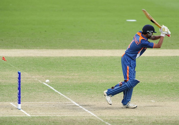 Ravikant Singh of India is bowled in his quest to take India to victory over Pakistan in the Quarter-final of the Under 19 World Cup. (Photo by Ian Hitchcock-ICC/Getty Images)
