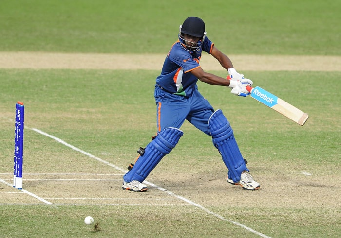 Baba Aparajith of India plays a late cut on the off side with precision. (Photo by Ian Hitchcock-ICC/Getty Images)