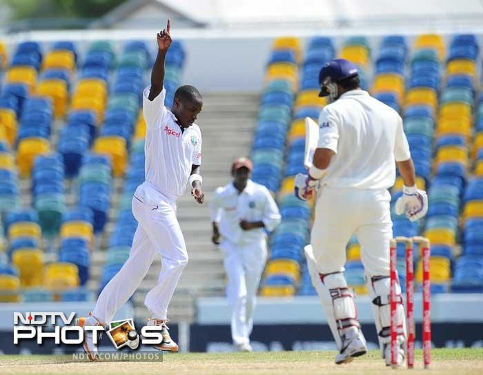 West Indies bowler Fidel Edwards celebrates after taking the wicket of Indian batsman Virat Kohli during the fifth day of the second Test match. (AFP Photo)