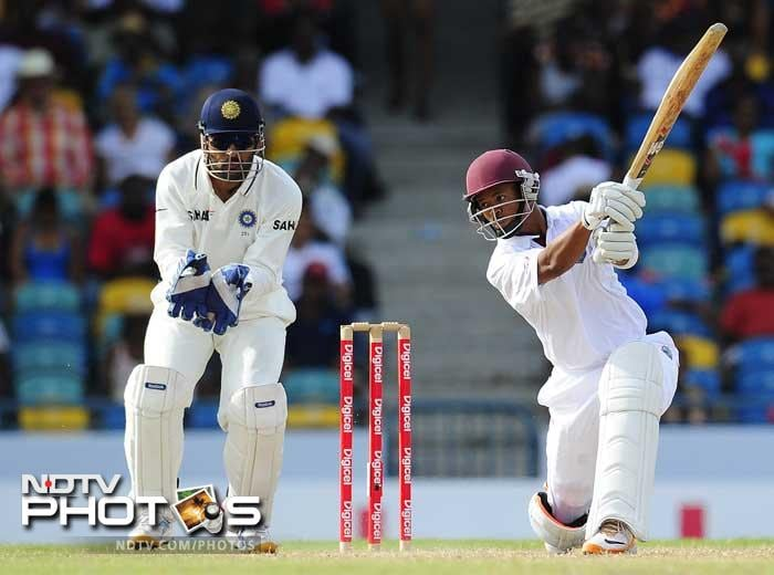 West Indies batsman Carlton Baugh hits a four as he provides a good support to his in-form partner Darren Bravo on the fifth day of the Test match. (AFP Photo)