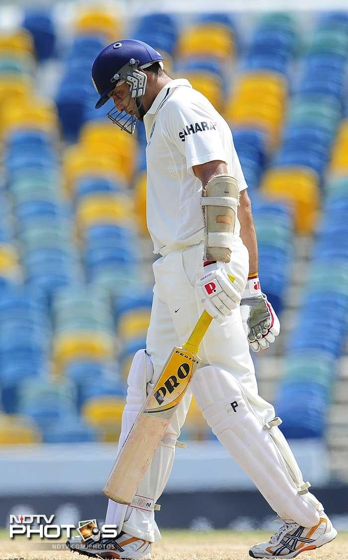 VVS Laxman leaves the field dejected as he missed out on his century after being dismissed on 87 on the fifth day of the second Test match. (AFP Photo)