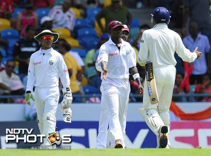 Harbhajan Singh leaves the field in front of West Indies players Fidel Edwards, Ramnaresh Sarwan and Carlton Baugh after India declared, during the fifth day of the second Test match. (AFP Photo)