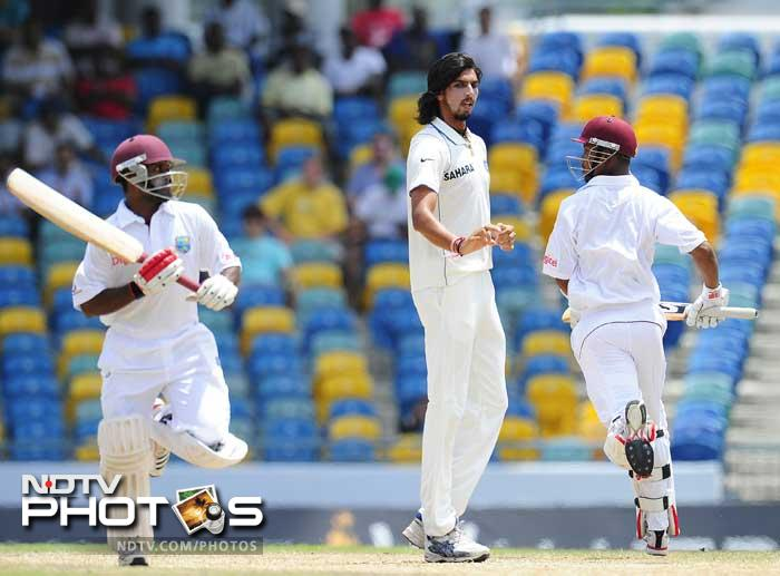 Ishant Sharma (C) reacts as West Indies batsman Adrian Barath (L) and Lendl Simmons score a run during the fifth day of the Test match. (AFP Photo)