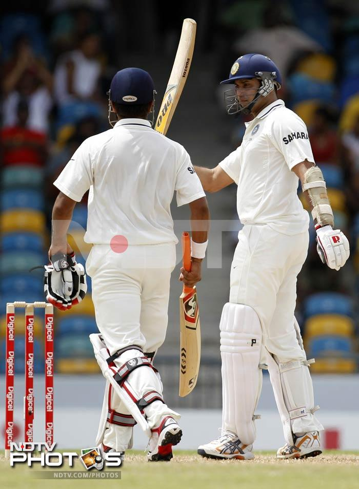 VVS Laxman combined forces with Suresh Raina, completed a half-century and staged a 117-run partnership for the 5th wicket on Day 1 of the 2nd Test match at Barbados.