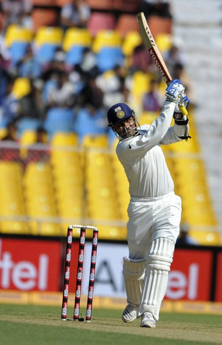 Virender Sehwag was at his murderous best against the toothless New Zealand bowling attack as he notched up his 22nd Test ton at Ahmedabad on the first day of the first Test. (AFP Photo)