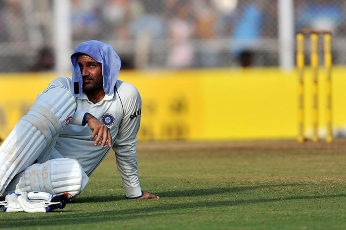 India's Virender Sehwag takes a break during his unbeaten 284 runs on the second day of the third Test against Sri Lanka in Mumbai. (AFP Photo)