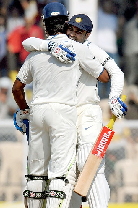 India's Virender Sehwag hugs his teammate Murali Vijay as he celebrates after scoring a century (100 runs) during play on the second day of the third Test match against Sri Lanka at The Brabourne Stadium in Mumbai. (AFP Photo)