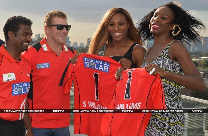 Serena and Venus are seen here with Muralitharan and Melbourne Renegades' skipper Finch.<br><br>The tennis players were presented with a team jersey.