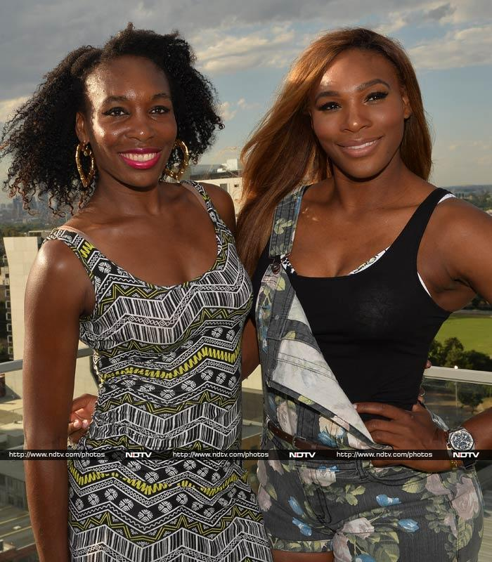Venus Williams (left) was largely part of the cheering squad but here, strikes quite a pose for the cameras.