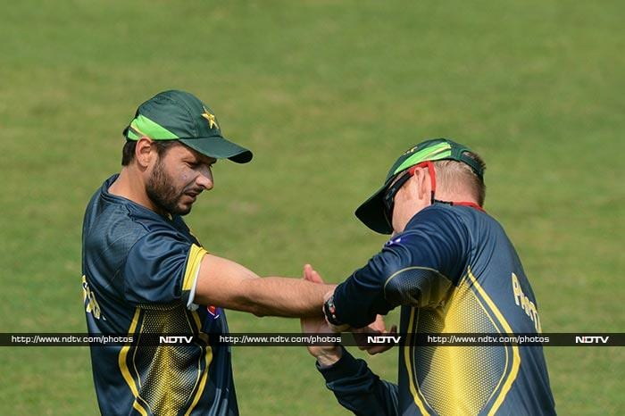 The physio takes a look at Afridi during training to make sure the muscles are in good shape.