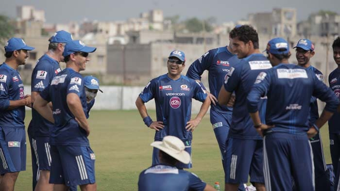 Sachin Tendulkar shares a light moment with his team during training.