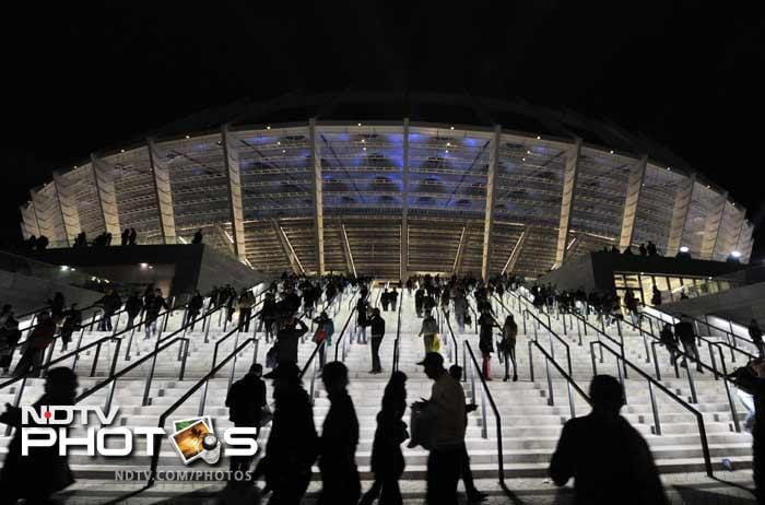 Visitors leave the newly reconstructed Olympiyskiy Stadium after the opening ceremony in Kiev.