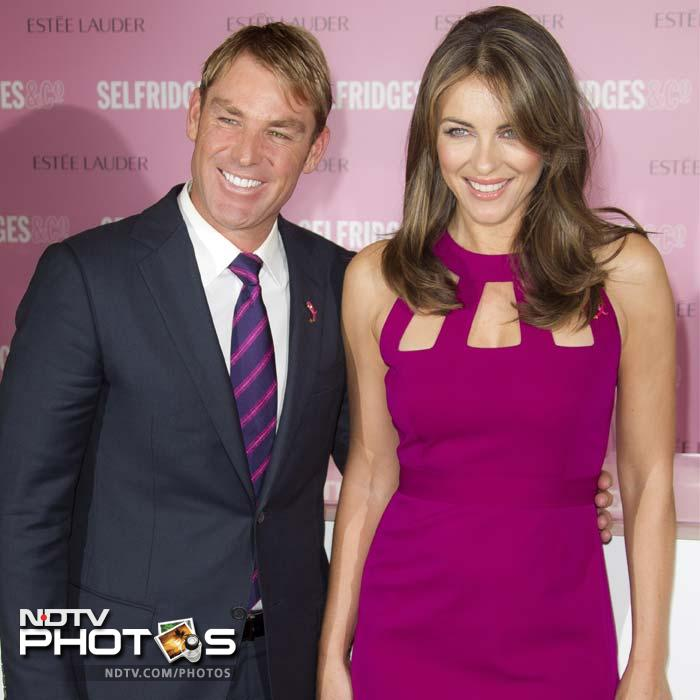 He took time off to be with Liz Hurley at London's Selfridges department store before she signed products in support of Breast Cancer Awareness.
