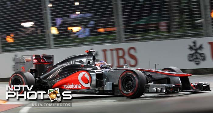 Jenson Button compensated for Lewis Hamilton's loss as he finished second behind Sebastian Vettel.