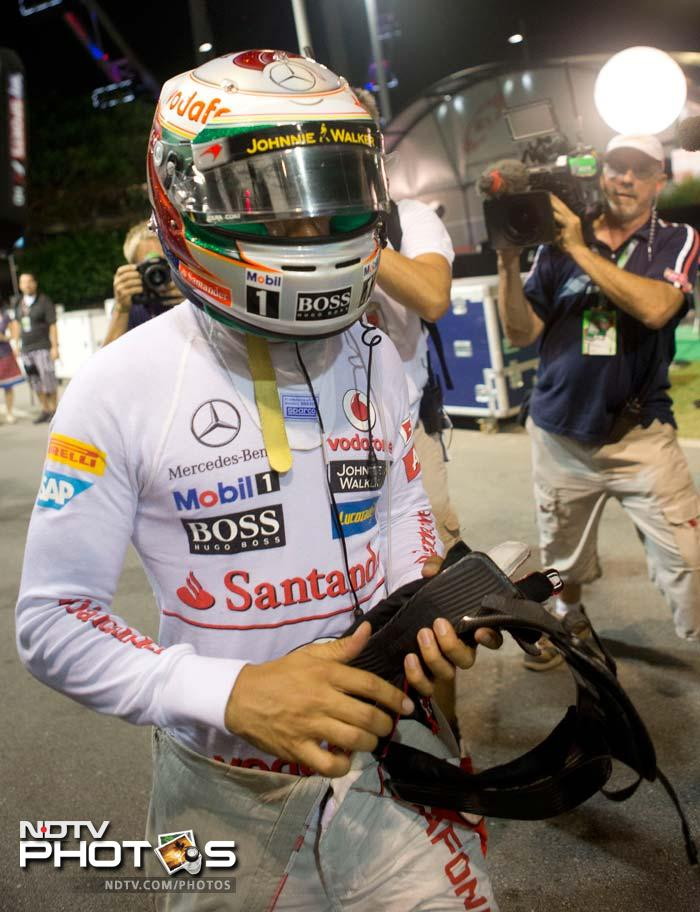 It was heartbreak for McLaren's Lewis Hamilton after he had to retire with gear-box failure. Hamilton had held on to his lead till the 22nd lap.