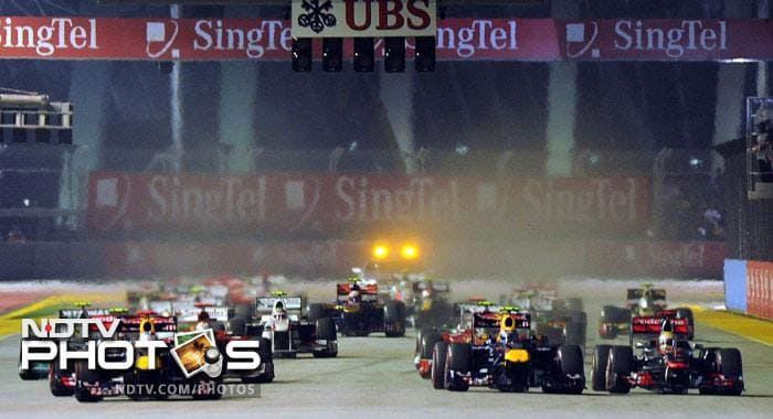 Formula One drivers power their cars at the start of Formula One's Singapore Grand Prix night race in Singapore. (AFP Photo)