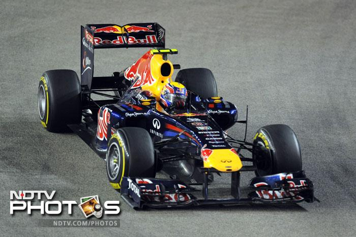 Red Bull-Renault driver Mark Webber of Australia powers his car during Formula One's Singapore Grand Prix night race in Singapore. (AFP Photo)