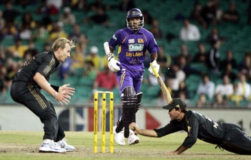 Sri Lanka's Chaminda Vaas, center, is run out by Australia's Ricky Ponting, right, as Brett Lee looks on at the Sydney Cricket Ground, in Australia, on Friday, February 8, 2008, during their one-day international cricket match. Australia made 253 in their innings.