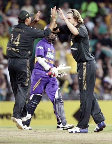 Nathan Bracken, right, celebrates with his captain Ricky Ponting, left, after Sri Lanka's Kumar Sangakkara, center was trapped LBW for 42 runs by Bracken at the Sydney Cricket Ground on Friday, February 8, 2008 during their one day international cricket match. Australia made 253 in their innings.