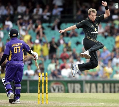 Brett Lee, right, jumps up after bowling out Sri Lanka's Sanath Jayasuriya, left, for 7 runs at the Sydney Cricket Ground on Friday, February 8, 2008 during their one-day international cricket match. Australia made 253 in their innings.