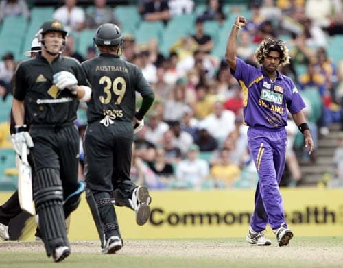 Lasith Malinga, right, celebrates after taking the wicket of Australia's James Hopes, second left, at the Sydney Cricket Ground on Friday, February 8, 2008 during their one-day international cricket match.