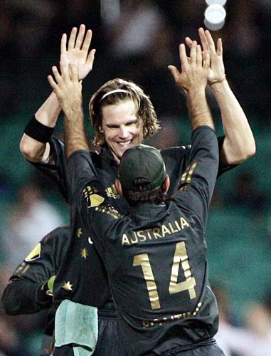 Ricky Ponting, front, reaches up to congratulate Nathan Bracken after he took 5 wickets against Sri Lanka at the Sydney Cricket Ground on Friday, February 8, 2008, during their one-day international cricket match. Australia won by 128 runs.
