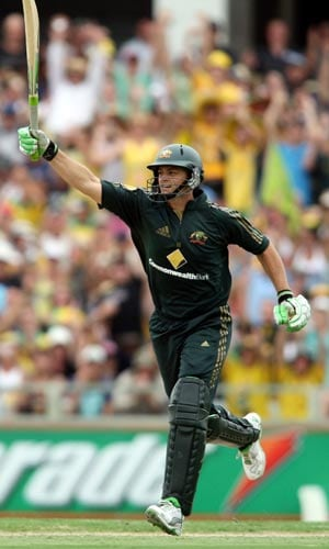 Australian batsman Adam Gilchrist celebrates scoring 100 runs during his innings in the one day match against Sri Lanka at the WACA ground in Perth on Friday, February 16, 2008.