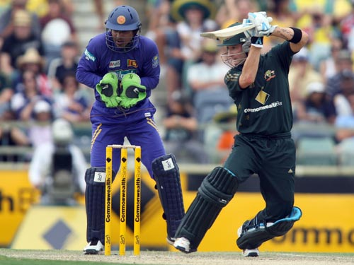 Australian batsman Michael Clarke, right, plays a shot during his innings in the one day cricket match against Sri Lanka at the WACA ground in Perth on Friday February 15, 2008. Wicketkeeper is Kumar Sangakarra, at left.